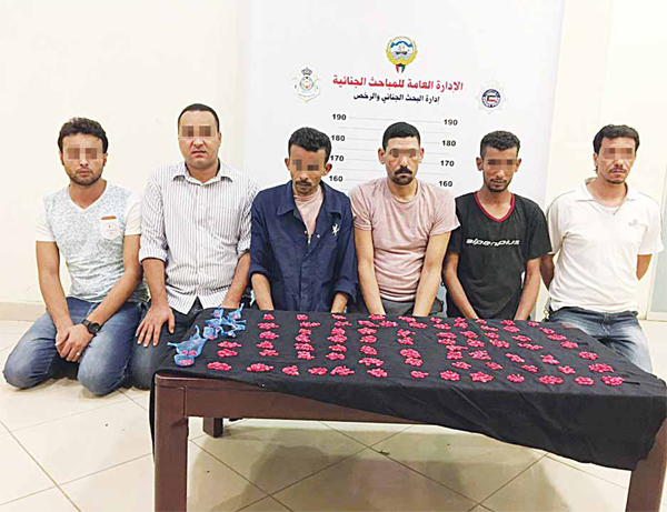 The accused photographed with the contraband found in their possession