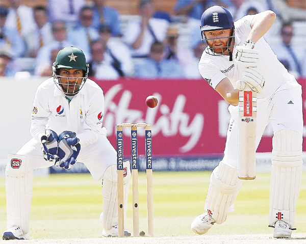 Pakistan's Sarfraz Ahmed (left), watches as England's Jonny Bairstow plays a shot on the fourth day of the first Test cricket match between England and Pakistan at Lord's cricket ground in London, on July 17. (AFP)