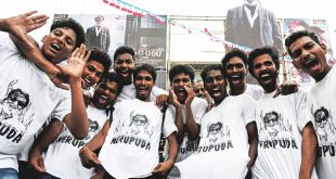 Indian fans of Bollywood star Rajinikanth wear T-shirts bearing his image on the first day of release of his new Tamil-language film 'Kabali' in Chennai on July 22. Fans of the wildly popular Indian film star Rajinikanth queued overnight for a 4 am screening of his eagerly awaited new movie on July 22, in the southern city of Chennai, where many companies gave up all hope of staff showing up for work and closed for the day. Tickets for 'Kabali', which stars Rajinikanth as an ageing gangster, sold out well before the release and were changing hands on the black market for up to 5,000 rupees ($75) — a huge sum for most Indians. (AFP)