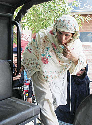 In this June 10, 2016 photo, Parveen Rafique, who killed her daughter Zeenat, leaves for a court appearance, in Lahore, Pakistan. (AP
