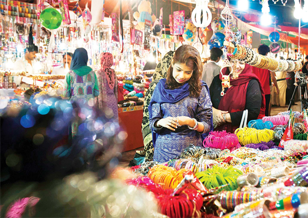 Pakistanis shop for traditional bangles for the upcoming Eid Al-Fitr holiday marking the end of the Islamic fasting month of Ramadan, in Islamabad, Pakistan on July 3. (AP)