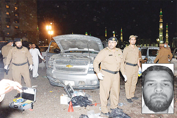Saudi security personal gather at the site of the suicide attack near the security headquarters of the Prophet's Mosque in Madinah City on July 4. Four Saudi security personnel were killed and five others were wounded in a suicide bombing Monday outside one of Islam's holiest sites, the Prophet's Mosque in Madinah, the interior ministry said. (inset) Abdullah Qalzar Khan Pakistani Resident who carried out the Jeddah attack (AFP)
