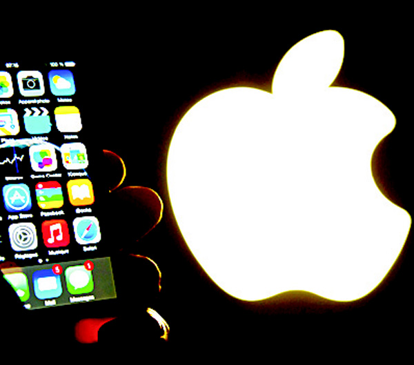 This file photo shows an iphone next to the Apple logo in Lille. (AFP)