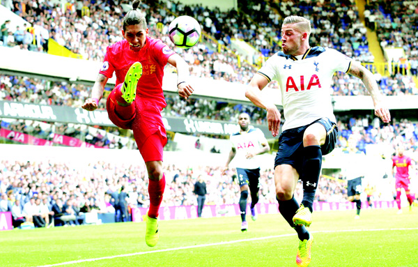 Liverpool's Roberto Firmino (left), competes for the ball with Tottenham's Toby Alderweired during the English Premier League soccer match between Tottenham Hotspur and Liverpool at White Hart Lane in London on Aug 27. (AP)