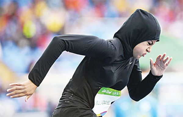 Saudi Arabia's Kariman Abuljadayel competes in the Women's 100m Preliminary Round during the athletics event at the Rio 2016 Olympic Games at the Olympic Stadium in Rio de Janeiro on Aug 12. (AFP)