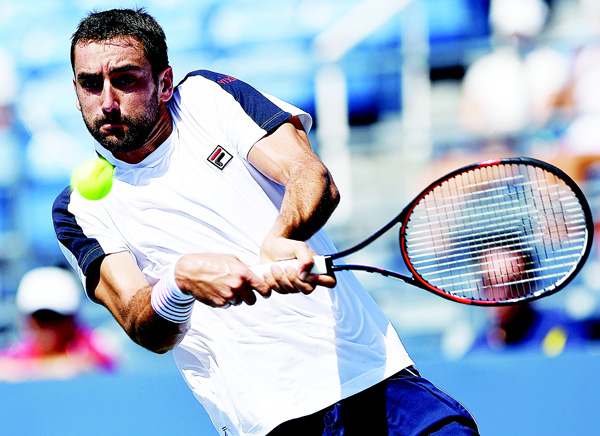 Marin Cilic of Croatia hits a return against Rogerio Dutra Silva of Brazil during their 2016 US Open Men's Singles match at the USTA Billie Jean King National Tennis Center in New York on Aug 29. (AFP)