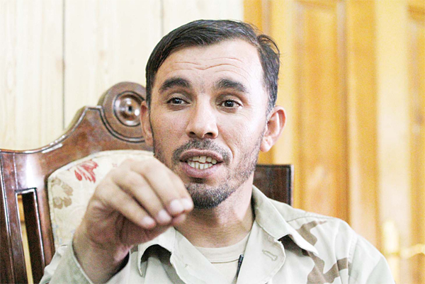 In this Aug 4 photo, Gen Abdul Raziq, Kandahar police chief, speaks during an interview with The Associated Press in Kandahar