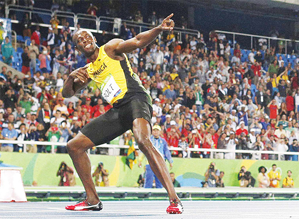Jamaica's Usain Bolt celebrates after he won the men's 200m Final during the athletics event at the Rio 2016 Olympic Games at the Olympic Stadium in Rio de Janeiro on Aug 18. (AFP)