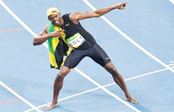 Jamaica's Usain Bolt celebrates after he won the men's 100m Final during the athletics event at the Rio 2016 Olympic Games at the Olympic Stadium in Rio de Janeiro on Aug 14. (AFP)