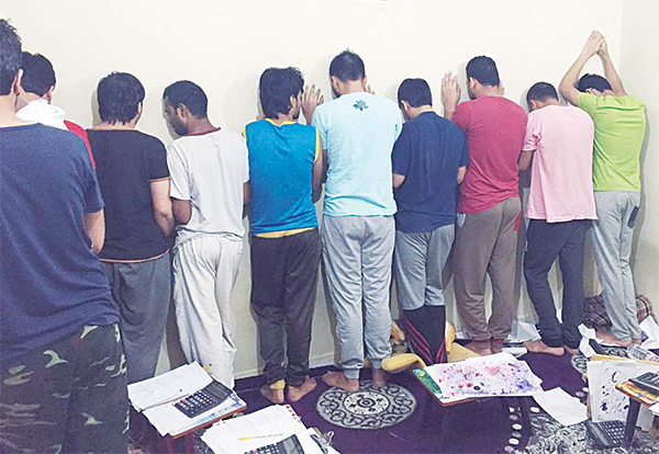 Some of the men caught gambling in an apartment.