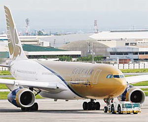 A Gulf Air passenger plane is towed by ground crew for inspection after it made an emergency landing about 25 minutes into the flight on Aug 5, at the Ninoy Aquino International Airport at suburban Pasay city, south of Manila, Philippines. (AP)