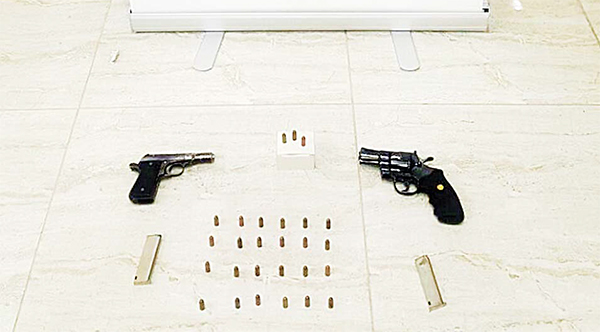 The two unlicensed guns and ammunition seized from the citizen