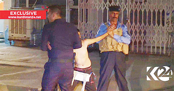 In this still taken from local TV footage, showing a child being restrained by security forces, holding his arms out-stretched as another cuts off a belt of explosives, on Aug 21, in Kirkuk, Iraq. Iraqi police say they have apprehended a boy would-be-suicide bomber in the city of Kirkuk before he was able to detonate his explosive belt. (AP)