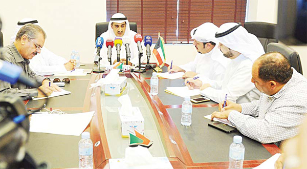 Minister of Commerce and Industry Dr Yousef Al-Ali affirmed that enforcing new fuel prices as of Sept 1 would not affect prices of commodities. Any unjustified bid to raise prices will be met with firm measures, he said, warning traders and businessmen. (Above): Dr Yousef Al-Ali chairs the meeting.