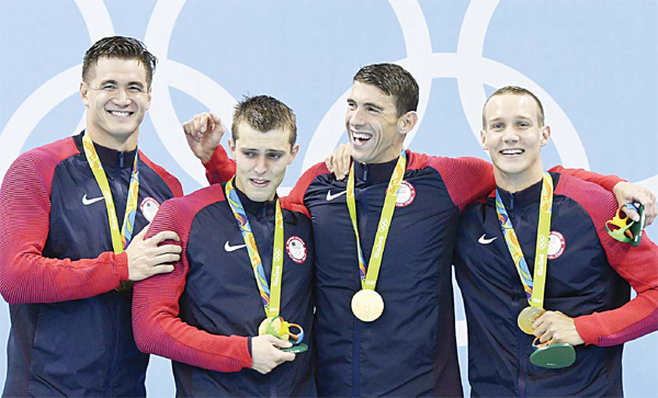(From left): USA's Nathan Adrian, USA's Ryan Held, USA's Michael Phelps and USA's Caeleb Dressel pose with their gold medal on the podium of the Men's 4x100m Freestyle Relay Final during the swimming event at the Rio 2016 Olympic Games. (AFP
