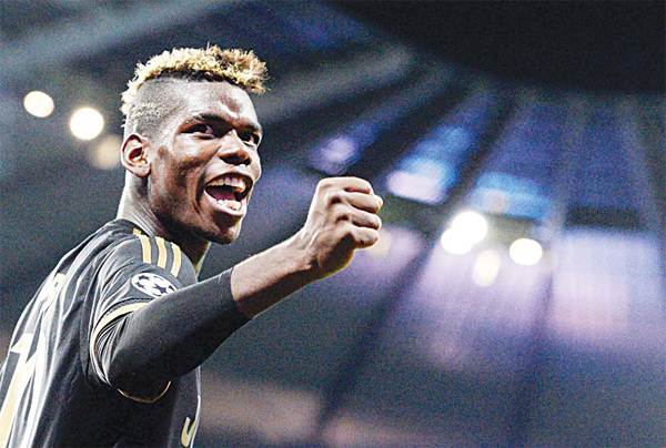 This file photo taken on Sept 15, 2015 shows Juventus' midfielder from France Paul Pogba celebrating a goal during a UEFA Champions League group stage football match between Manchester City and Juventus at the Etihad Stadium in Manchester, north-west England. (AFP)