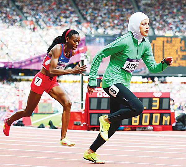 This file photo taken on Aug 8, 2012 shows (from left): Central Africa Republic's Elisabeth Mandaba, Colombia's Rosibel Garcia and Saudi Arabia's Sarah al-Attar competing in the women's 800m heats at the athletics event of the London 2012 Olympic Games in the capital. Pioneer Saudi sportswoman Sarah al-Attar has already raced at the Olympics, but now her campaign will become a marathon as she uses the Rio Games in August 2016 to break down barriers in the conservative kingdom. (AFP)