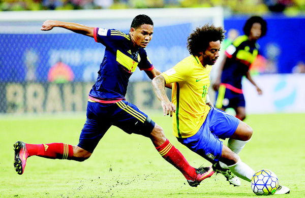 Brazil's Marcelo (right), dribbles the ball past Colombia's Carlos Bacca during a 2018 World Cup qualifying soccer match in Manaus, Brazil on Sept 6. (AP)