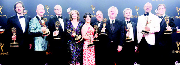 Cast and crew pose with the Emmy for Outstanding Limited Series for 'The People vs. O.J. Simpson: American Crime Story',  in the press room during the 68th Emmy Awards on Sept 18, at the Microsoft Theatre in Los Angeles. (AFP)