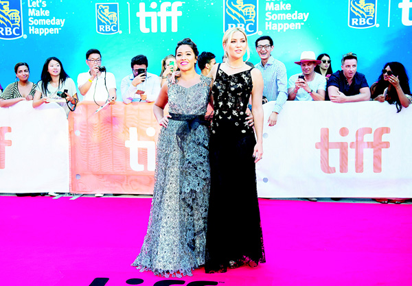 Actors Gina Rodriguez, (left), and Kate Hudson pose on the red carpet for the premiere of 'Deepwater Horizon' during the 2016 Toronto International Film Festival in Toronto on Sept 13. (AP)