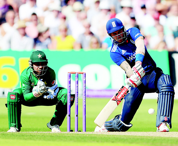 England's Alex Hales bats watched by Pakistan wicket keeper Sarfraz Ahmed during the third one day international cricket match at Trent Bridge, Nottingham, England on Aug 30. (AP)