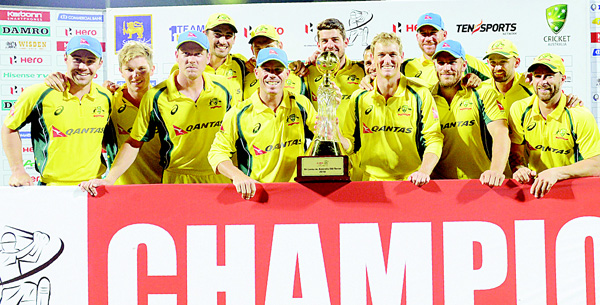 Australia's players pose for photographers after their victory in the final one day international (ODI), cricket match between Sri Lanka and Australia at the Pallekele International Cricket Stadium in Pallekele on Sept 4. (AFP)
