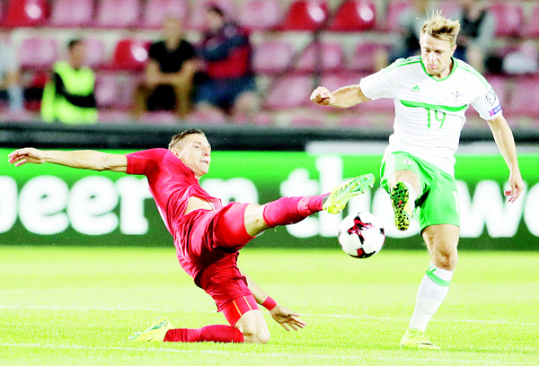 Czech Republic's David Pavelka (left), challenges Northern Ireland's Jamie Ward (right), during their World Cup Group C qualifying soccer match in Prague, Czech Republic on Sept 4. (AP)