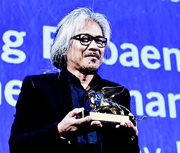 Director Lav Diaz holds the Golden Lion award for Best Film for the movie 'The Woman Who Left' during the awards ceremony of the 73rd Venice Film Festival on Sept 10, at Venice Lido. (AFP)