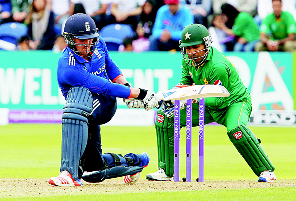 England's Jason Roy (left), plays a shot as Pakistan's Sarfraz Ahmed keeps wicket during play in the fifth one day international (ODI) cricket match between England and Pakistan at The SWALEC Stadium in Cardiff, south Wales,  on Sept 4. (AFP)