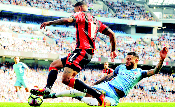 Manchester City's Nicolas Otamendi (right), and Bournemouth's Joshua King compete for the ball during the English Premier League soccer match between Manchester City and Bournemouth at the Etihad Stadium in Manchester, England, on Sept 17. (AP)