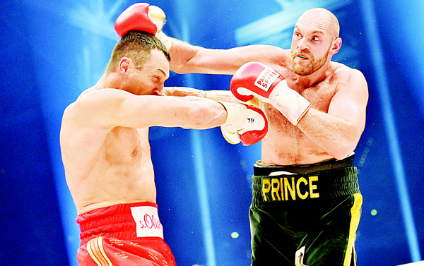 In this Nov 28, 2015 picture, Ukraine's Wladimir Klitschko (left), and Britain's Tyson Fury compete in a world heavyweight title fight for Klitschko's WBA, IBF, WBO and IBO belts in the Esprit Arena in Duesseldorf, western Germany. (AP)