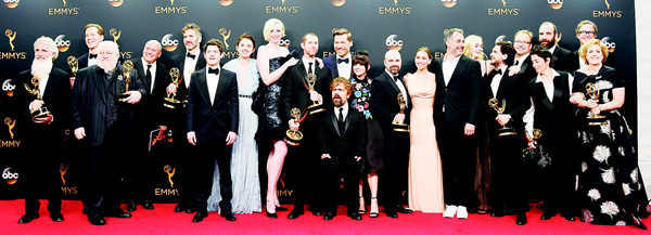 The cast and crew of 'Game of Thrones', winners of the award for outstanding drama series, pose in the press room at the 68th Primetime Emmy Awards on Sept 18, at the Microsoft Theater in Los Angeles. (AP)