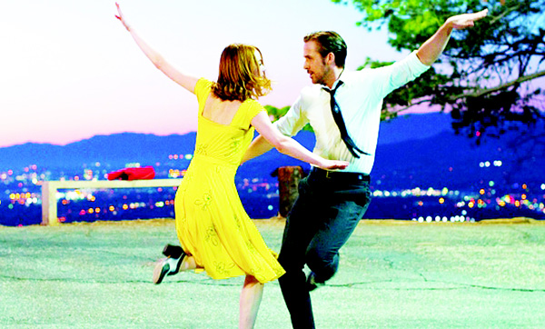 This image released by Summit Entertainment shows Ryan Gosling (right), and Emma Stone in a scene from 'La La Land', in theaters on Dec 2. (AP)