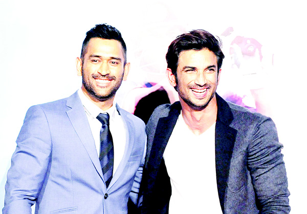 In this photograph taken on Aug 11, 2016, Indian Bollywood actor Sushant Singh Rajput (right), and Indian cricket captain Mahendra Singh Dhoni pose during the trailer launch in Mumbai of the upcoming biographical film 'MS Dhoni: The Untold Story' directed by Neeraj Pandey. (AFP)