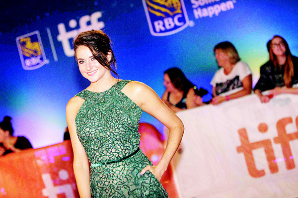 Shailene Woodley poses for photos at the premiere for 'Snowden' at the Toronto International Film Festival in Toronto, Canada, Sept 9. (AFP)