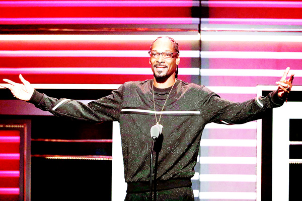 Snoop Dogg speaks while being honored with the 'I Am Hip Hop' award at the BET Hip-Hop Awards in Atlanta, on Sept 17. (AP)