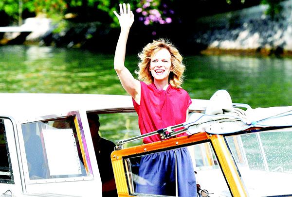 Italian actress Sonia Bergamasco waves from a boat as she arrives at the Venice Lido, Italy, Aug 30, where she will MC the 73rd edition of the Venice Film Festival standing on Aug 31 through Sept 10. (AP)