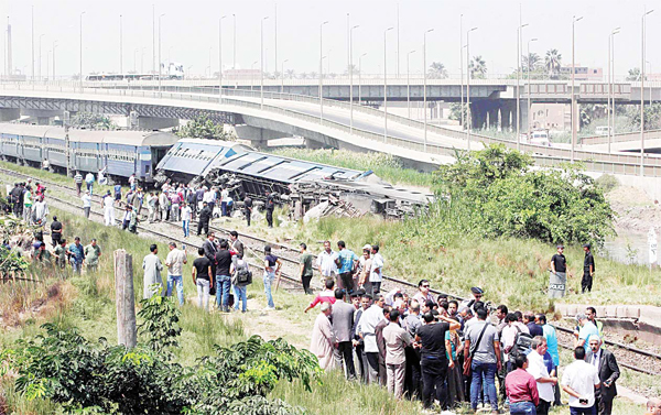 Egyptians check the wreckage of a train after it derailed near the village of Al-Ayyar in Giza on the southern outskirts of the capital Cairo on Sept 7. The conductor suddenly hit the breaks when he spotted a problem with the tracks, causing three carriages to overturn, officials said. (AFP)