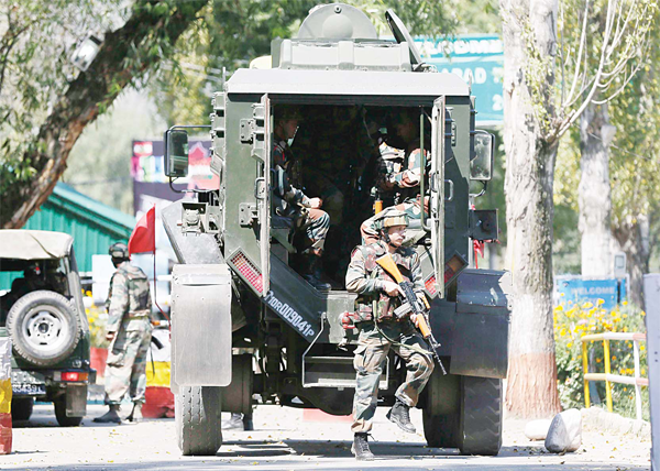 Indian army soldiers arrive at the army base which was attacked by suspected rebels in the town of Uri, west of Srinagar, Indian controlled Kashmir on Sept 18. (AP)