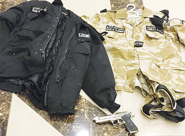 The military uniform and toy gun seized from the Iranian expat