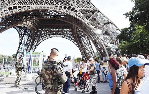 Police officers patrol around the Eiffel tower in Paris on Sept 10, Three heavily radicalised women were arrested after car laden with gas cylinders was found abandoned near Notre Dame cathedral in Paris on Sept 4. (AFP)
