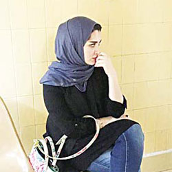 Sarah Al-Durees awaiting interrogation by Prosecution