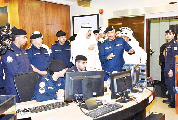 Acting Prime Minister and Minister of Interior Sheikh Mohammad Al-Khaled Al-Hamad Al-Sabah during his visit to the headquarters of Traffic Department at the beginning of new scholastic year.