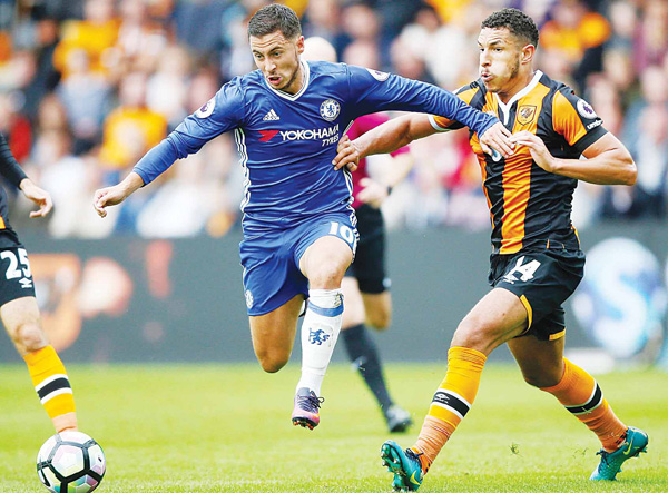 Chelsea's Eden Hazard (left), and Hull City's Jake Livermore battle for the ball, during the English Premier League soccer match between Hull City and Chelsea, at the KCOM Stadium in Hull, England on Oct 1. (AP)