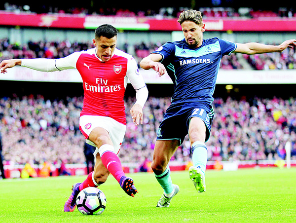 Arsenal's Chilean striker Alexis Sanchez (left), vies with Middlesbrough's Uruguayan midfielder Gaston Ramirez (right), during the English Premier League football match between Arsenal and Middlesbrough at the Emirates Stadium in London on Oct 22. (AFP)