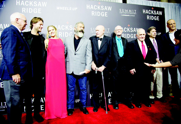 Actor Luke Bracey (second from left), actress Teresa Palmer, director Mel Gibson, World War II veterans Joe Clapper, RV Burgin, Robert Akins, and Desmond Doss Jr and actor Vince Vaughn pose on the red carpet at a screening of the movie 'Hacksaw Ridge', at The National WWII Museum, in New Orleans, on Oct 26. The film depicts the life of conscientious objector and Congressional Medal of Honor recipient, Desmond Doss. (AP)