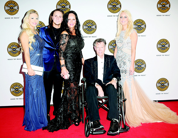 (Third from left), Mary Travis and artist Randy Travis (seated), with family on the red carpet of the Country Music Hall of Fame Medallion Ceremony at the Country Music Hall of Fame and Museum on Oct 16 in Nashville, Tenn. (AP)
