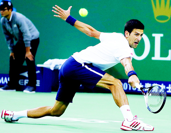 Novak Djokovic of Serbia hits a return shot against Vasek Pospisil of Canada during the men's singles match of the Shanghai Masters tennis tournament at Qizhong Forest Sports City Tennis Center in Shanghai, China on Oct 13. (AP)