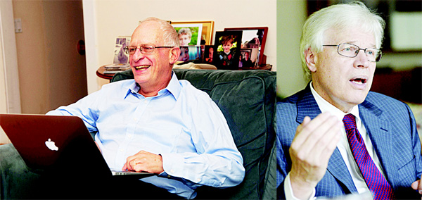 In this photo provided by Harvard University, Oliver Hart, the Andrew E. Furer Professor of Economics at Harvard, reads congratulatory emails at his home in Lexington, Massachusetts on Oct 10 after winning the Nobel Prize in economics. Hart and Finnish economist Bengt Holmstrom, of the Massachusetts Institute of Technology, share the award for their contributions to contract theory. (AP) In this file photo, Finnish Professor Bengt Holmstrom of Massachusetts Institute of Technology attends a business seminar in Helsinki, Finland. (AP)