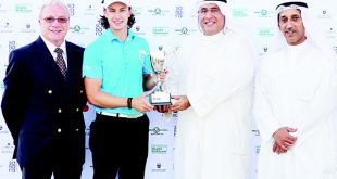 Jeo Heraty receiving the winner's trophy from Yousef Abdulaziz Al Qatami of Sahara Kuwait as Rod Bogg of the MENA Golf Tour, and Wael Abdulrahman Al Welayti, also of Sahara Kuwait, look on.
